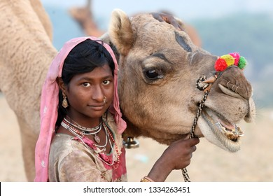 PUSHKAR, INDIA - NOVEMBER 16, 2018: Unidentified tribal Gypsy girl at the Pushkar Camel Fair, Rajasthan. The fair is the largest camel fair in India.