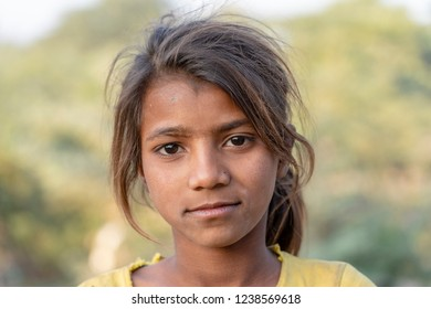 PUSHKAR, INDIA - NOVEMBER 17, 2018 : Indian young girl in the desert Thar on time Pushkar Camel Mela near holy city Pushkar, Rajasthan, India, close up portrait