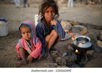 PUSHKAR, INDIA - NOVEMBER 19, 2018: Unidentified poor Gypsy children at the Pushkar Camel Fair, Rajasthan. The fair is the largest camel fair in India.