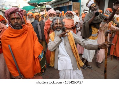 PUSHKAR, INDIA - NOVEMBER 20, 2018: Unidentified Sadhus in the streets of Pushkar at the Camel Fair, Rajasthan. The fair is the largest camel fair in India.