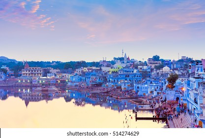 PUSHKAR, INDIA - NOVEMBER 21, 2012: Hindu pilgrims came to sacred Lake Pushkar (Sarovar) on ghats. Countless people in colourful attire gather to take a dip in the Holy Lake and pray to deities.