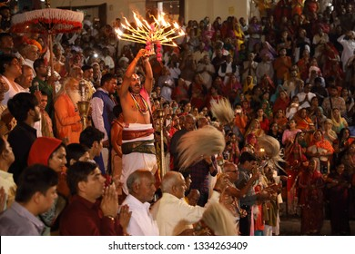PUSHKAR, INDIA - NOVEMBER 22, 2018: Unidentified pilgrims witness the Maha Aarti at Varaha ghat during the Camel Fair in Pushkar, Rajasthan. The fair is the largest camel fair in India.