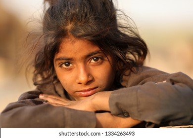 PUSHKAR, INDIA - NOVEMBER 22, 2018: Unidentified Gypsy girl at the Pushkar Camel Fair, Rajasthan. The fair is the largest camel fair in India.