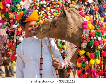 PUSHKAR, INDIA - NOVEMBER 22: Camel and his owner at traditional camel decoration competition at camel mela in Pushkar on November 22,2012 in Pushkar, Rajasthan, India