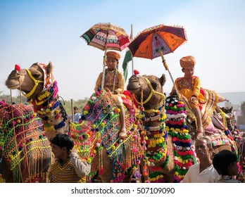 PUSHKAR, INDIA - NOVEMBER 22,2012: Many adults and children attends at traditional camel decoration competition at camel mela in Pushkar. People from all over Rajasthan flock to annual fair.