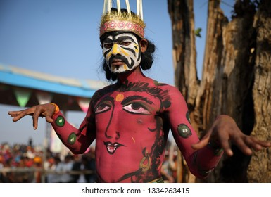 PUSHKAR, INDIA - NOVEMBER 23, 2018: Unidentified mask dancer at the closing ceremony of the Pushkar Camel Fair, Rajasthan. The fair is the largest camel fair in India.