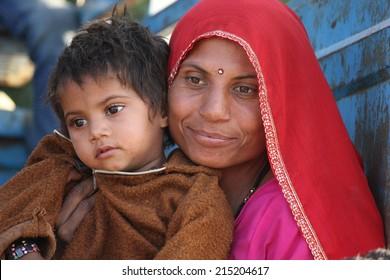 Pushkar, India, November 28 2012: A beautiful Indian Mum with her son.