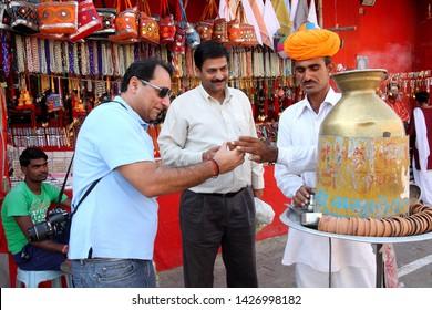 Pushkar, India, November 5th 2011 : Man selling indian masala tea called chai wala (Tea seller) on the street of Pushkar town of Rajasthan state