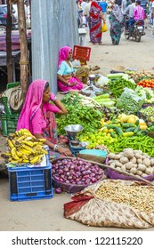 PUSHKAR, INDIA - OCT 20: Unidentified vendors sell vegetables in the market on Oct. 20,2012 in Pushkar, India. Agricultural sector makes up 18.1% of GDP. India is a big producer for vegetables.