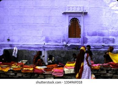 PUSHKAR, INDIA - OCT 22, 2003 - Colored textiles for sale outside city wall,Pushkar, India