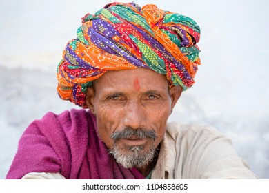 PUSHKAR, INDIA - OCTOBER 25, 2014 : A Rajasthani tribal man wearing traditional colorful turban attends the annual Pushkar Cattle Fair, Pushkar, Rajasthan, India