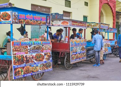 Pushkar, Rajasthan / India 06 09 2018: Fast food vendors several stalls on the main street in Pushkar.