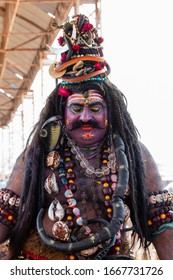 Pushkar, Rajasthan / India - November 2019 : Indian artist in lord shiva get up in pushkar camel fair to attract tourists
