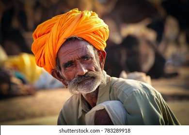 Pushkar, Rajasthan, India - November 24, 2012 : Portrait of a Rajasthani Indian man dressed in traditional attire with turban (Pagadi) on his head at Pushkar camel Fair (Pushkar Mela)