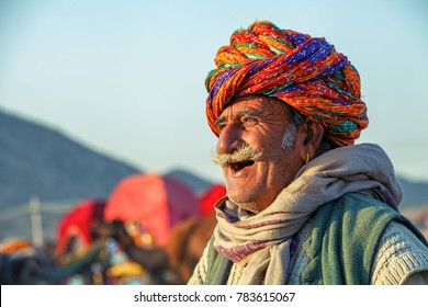 Pushkar, Rajasthan, India - November 24, 2012 : An unidentified happy and smiling old man at Pushkar Camel Fair (Pushkar Cattle Mela)