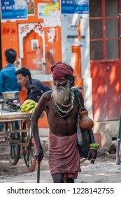 PUSHKAR, RAJASTHAN - OCT 23, 2011: a Hindu sadhu walks the streets of Pushkar in the direction of the lake where he will perform ritual ablutions, in Pushkar on October 23, 2011.