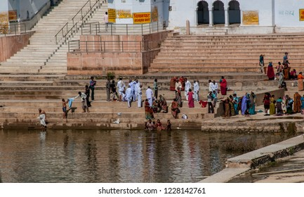 PUSHKAR, RAJASTHAN - OCT 23, 2011: hundreds of pilgrims flock to the ghats of Pushkar Lake for purifying ablutions rituals, in Pushkar on October 23, 2011.