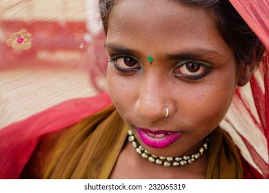 PUSHKAR,INDIA - October 31,2014 : Unidentified young Indian women dress their colorful and traditional scarfs in Pushkar Mela (Pushkar Camel Fair ).