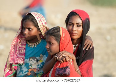 Pushkar,India-October 30, 2017: Portrait of Indian woman with her colorful and traditional sari and scarfs  in Pushkar Mela.