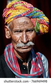 Pushkar,India-October 30,2017: Portrait of traditionally dressed Indian man during Pushkar Camel Fair.Most of the men in Rajasthan like to grow thick mustache