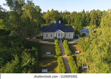 PUSHKIN MOUNTAINS, RUSSIA - JUNE 11, 2018: The house of the poet A.S. Pushkin in a manor Mikhaylovsky in the May morning. Pushkin Hills, Russia