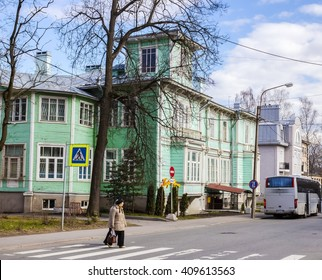 "PUSHKIN, RUSSIA - APRIL 16, 2016: architecture of small historic towns in Russian province. The two-storey wooden house with balconies, bay windows,platbands and a mezzanine..The sign ""Cafe Europe"""