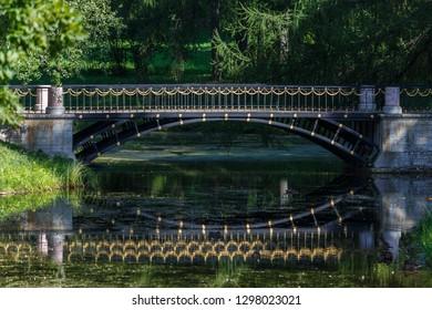 PUSHKIN / RUSSIA - AUGUST 2015: Decorated bridge in the park, Pushkin (Tsarskoe Selo), Russia