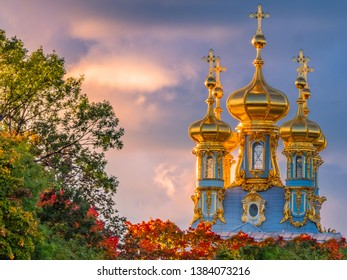 Pushkin. Russia. Catherine palace. The Catherine Palace domes are illuminated by the sunset sun. Tsarskoye Selo in autumn. Cultural heritage of Russia. Leningrad region. Tours of Pushkin.