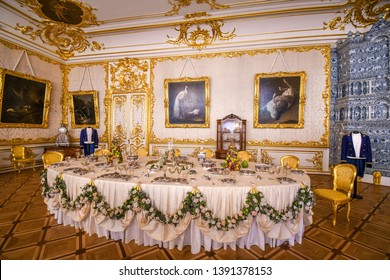 Pushkin, Russia - September 11 2018: A lavish table setting inside the royal Catherine's Palace in Pushkin, near St Petersburg Russia.