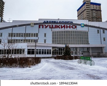 PUSHKINO, RUSSIA, january 6. City landscape in the winter cloudy afternoon. Sports palace on the river bank of Serebryanka