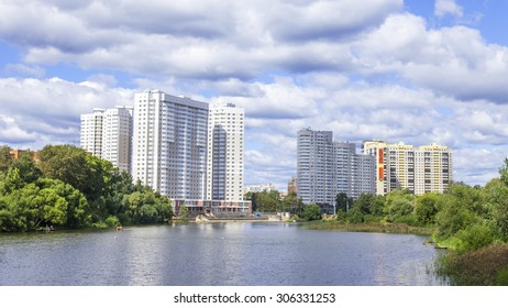 PUSHKINO, RUSSIA - on AUGUST 15, 2015. Picturesque city landscape. New multystoried houses on the river bank of Serebryanka