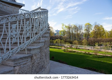 PUSHKIN/RUSSIA-05.22.2017.A fragment of an openwork staircase leading to the gallery of the Catherine Park and a view of the Park itself. There are no people.