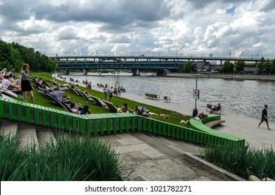 Pushkinskaya embankment of the Moscow River, sun loungers for sunbathing, Moscow, Russia, 3 August 2017