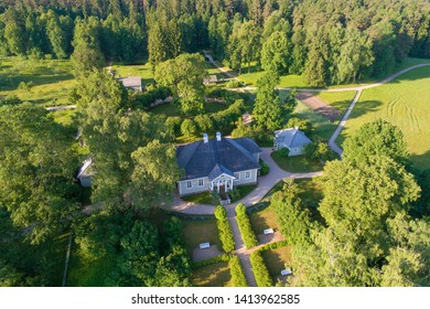 PUSHKINSKIE GORY, RUSSIA - JUNE 18, 2018:A view from the height of the house of the poet A.S. Pushkin in the Mikhailovsky Manor on a sunny June day (aerial photography)