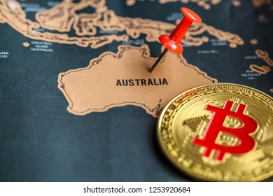 Pushpin and bitcoin on Australia part of world map. Investment in / mining of bitcoin in Australia concept.