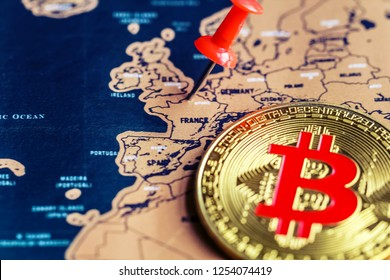 Pushpin and bitcoin on France (map). Investment in / mining of bitcoin in France concept.