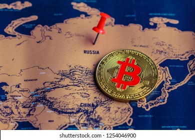 Pushpin and bitcoin on Russia (map). Regulations of bitcoin in Russia concept.
