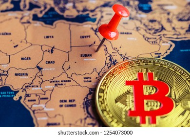 Pushpin and bitcoin on Sudan part of world map. Regulations of cryptocurrency in Sudan concept.