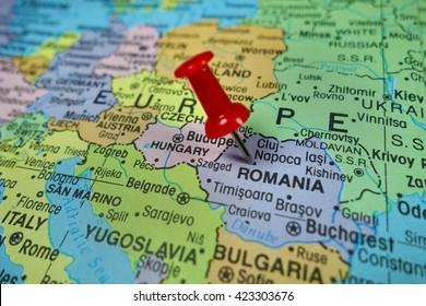 Pushpin marking on Romania map