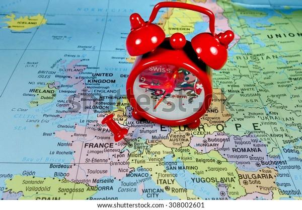 Pushpin marking on Switzerland map with swiss clock