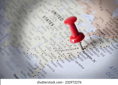 Pushpins with bright light focused on map detail, Important business trip or vacation reminder concept