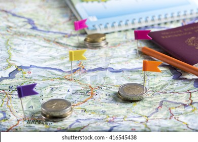 pushpins on the geographical map to plan a trip.
