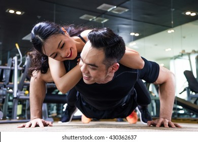 push-ups with woman on back, healthy couple, workout with own body weight, outdoor