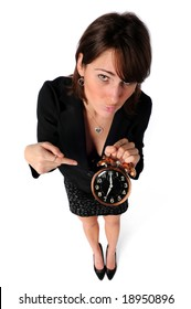Pushy businesswoman pointing to alarm clock isolated over a white background