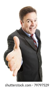 Pushy salesman with an oversized grin, coming in for a handshake.  Isolated on white.