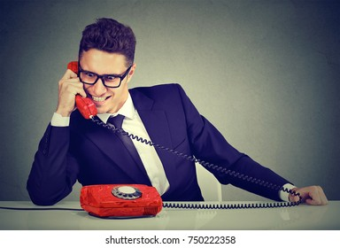 Pushy young salesman business man advertising his best product on a phone