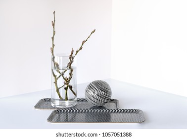 Pussy willow branches in simple glass vase.