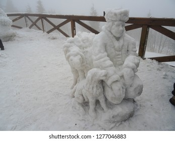 Pustevny / Czech Republic - 01 27 2018:  sheep shepherd and his dog, snow sculptures displayed in white winter on Pustevny in Beskydy mountains, Silesia region, Czech Republic, Central Europe