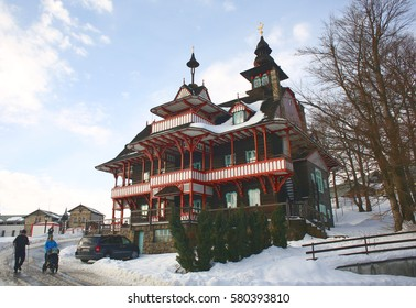PUSTEVNY, CZECH REPUBLIC, FEBRUARY 1, 2017: Mamenka historical architecture building Pustevny Beskids mountains 1898, style slavic folk, secession Wallachian, Jurkovic, people, winter, Europe