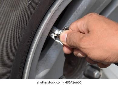 Measuring Tread Wear On Tire On Stock Photo Edit Now 534275290
